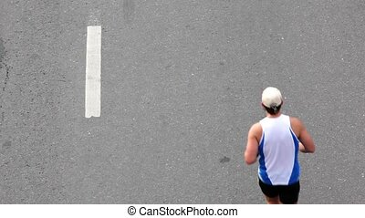 Man in sport wear run on asphalt