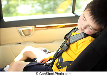 Toddler asleep in a child safety seat in a car.