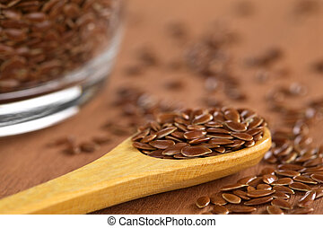 Brown Flax Seeds - Brown flax seeds on wooden spoon with...