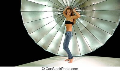 model dances in front of reflector in photo studio - Long...