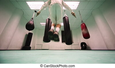 man quickly jumps on rope in hall boxing - man quickly jumps...