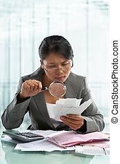 Asian bussinesswoman checking bills