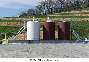 Storage tanks on a gas well site - Storage tanks on a gas...