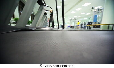 treadmill at large gym, distance in defocusing people are trained to walk