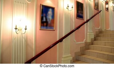 Interior with lanterns and pictures on wall and staircase...