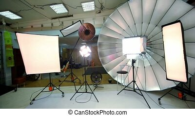 Young model walk inside photo studio, panoramic view