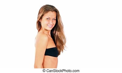model in black bra looks and smile isolated on white