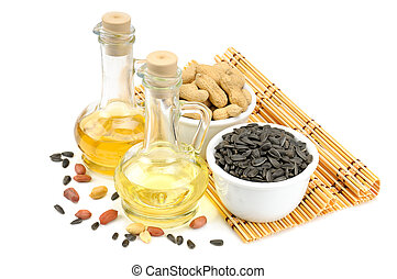 Sunflower seeds, peanuts and bottle of oil isolated on a...