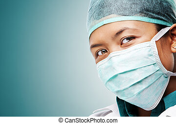 Female medical worker gazing to camera with all her...