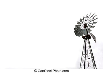 Wind mill for water pumping over white with copy space