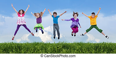 Happy spring jump - Happy children jumping on the spring...