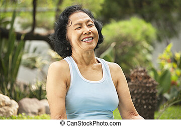 Senior woman laught at park - Senior Asian woman laught at...