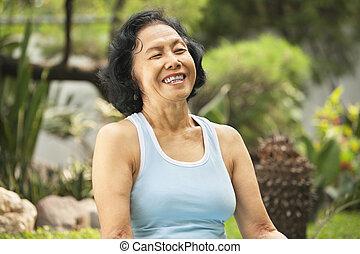 Senior woman laught at park - Senior Asian woman laught at...