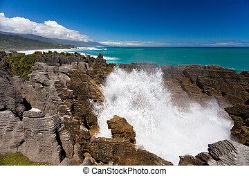 Surf in blowhole Pancake Rocks of Punakaiki, NZ
