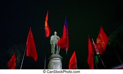 Several communistic flags in front of Griboyedov monument