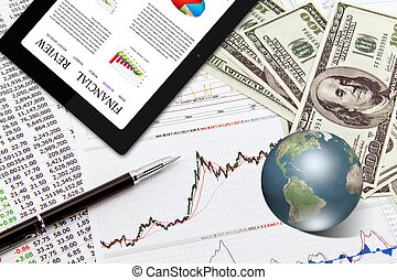 Business graph,touchpad, pen,earth and dollars on table