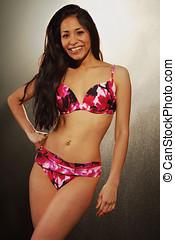 beautiful woman in bikini covered with water