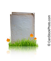 Book with flower and grass