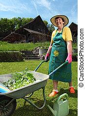 Planting vegetables in her garden