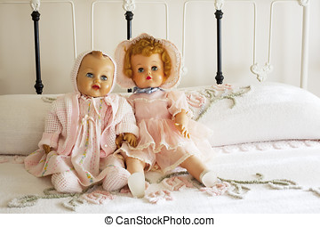 Two Vintage Dolls on Chenille Bedspread on Iron Bed - Two...