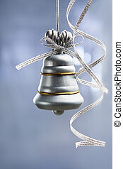 SIlver Christmas bell over blue background - SIlver...