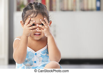 Little girl playing peekaboo - Little Asian girl playing...