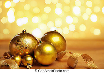 Golden Christmas ornaments with blur light