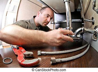 plumber ta work - portrait of caucasian plumber at work
