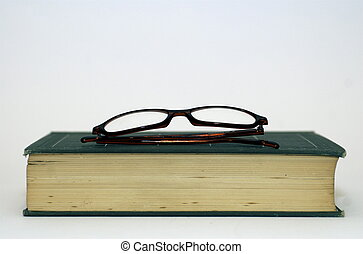Spectacles On Old Book