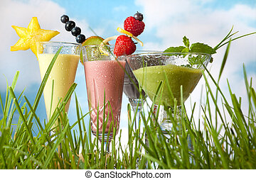 Summer smoothies in the garden - Four summer fruit smoothies...