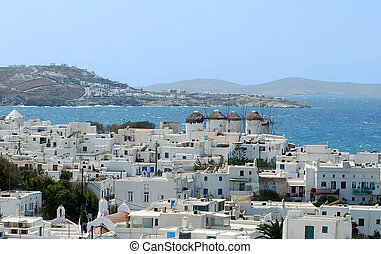 Mykonos - White houses descending to a bay from hills of...