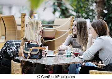 cute smiling women drinking a coffee - very cute smiling...