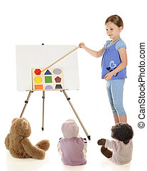 Teaching About Shapes - A young elementary girl teaching her...