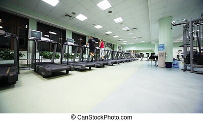 people are trained to walk on treadmill in gym - people are...