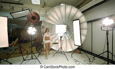 Young model walk away photo studio, professional equipment...