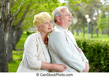 Rest in park - Mature woman and her husband having rest...
