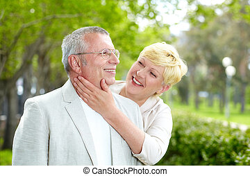 Happy mature couple - Portrait of happy mature woman looking...