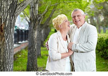 Happy mood - Happy mature woman looking at her husband while...