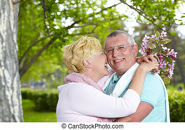 Love and affection - Happy mature woman embracing her...