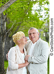 Affection - Mature woman looking at her husband while having...