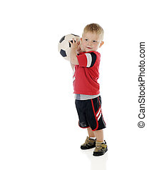 Tossing the Soccer Ball - An adorable 2-year-old preparing...
