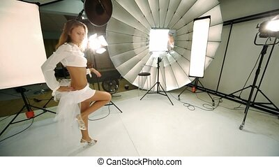 Young model walk inside photo studio - Young model in white...