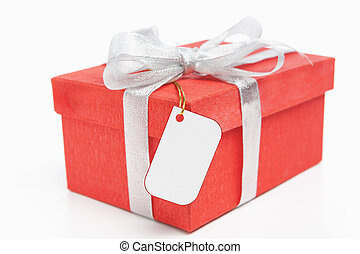 Red Christmas gift with blank tag