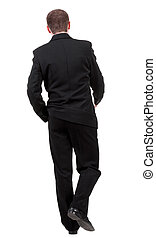 back view of going business man walking young guy in black...