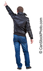 Back view of  man in jacket  pointing.