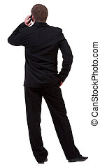 back  view of business man in black suit  talking on mobile phone. people collection. Rear view .  Isolated over white background. backside view of person.