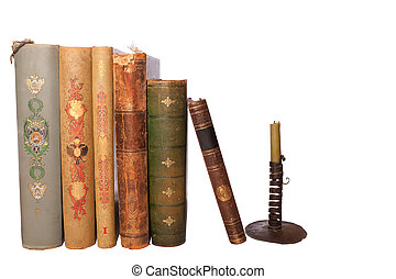 stack antique books and candlestick
