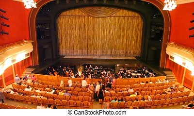 In big theatre many people take places for viewing