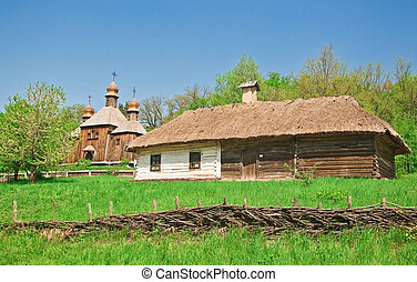 ukrainian old log hut and church in forest