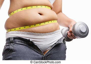 fat woman holding weight to exercise with measuring tape...
